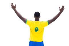 Football player in yellow celebrating a win Stock Images