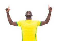 Football player in yellow celebrating a win Royalty Free Stock Photo