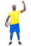 Football player in yellow celebrating a win Royalty Free Stock Photos