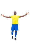 Football player in yellow celebrating a win Stock Image