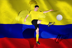 Football player in yellow kicking Stock Photography