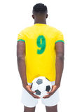 Football player in yellow standing with the ball Royalty Free Stock Photo