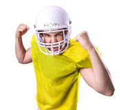 Football Player on yellow uniform isolated on white background Stock Photo