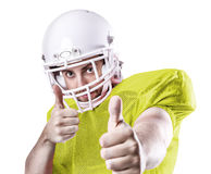 Football Player on yellow uniform isolated on white background.  Stock Photos