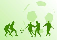 Football players. Green siolnouettes of football players on the green background with ball Stock Photos