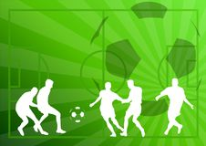 Football players. White silhouettes of football players on the green background Royalty Free Stock Photo