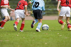 Football players. Detail of a soccer game with four players in action Stock Image