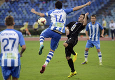 Football players in action. OFK's Marko Jankovic pictured in action during the friendly game between CSU Craiova and OFK Belgrade. CSU won, 2-1 Royalty Free Stock Images