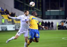 Football players in action. Petrolul's Soni Mustivar pictured in action during the Romanian League 1 game between Petrolul Ploiesti and Gaz Metan Medias royalty free stock photo