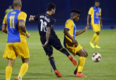 Football players in action. Petrolul's Sony Mustivar pictured in action during the Europa League play-off game between Dinamo Zagreb and Petrolul Ploiesti Stock Photo