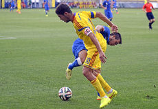 Football players in action Stock Images