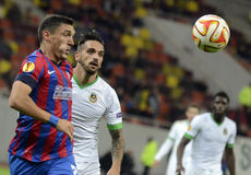 Football players in action. Steaua and Rio Ave  players pictured in action during UEFA Europa League game between Steaua Bucharest and Rio Ave. Steaua won, 2-1 Royalty Free Stock Photo
