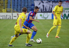 Football players in action. Steaua's Alexandru Chipciu pictured in action during the Romanian League One game between Steaua Bucharest and Ceahlaul Piatra Neamt Royalty Free Stock Photos