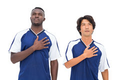 Football players in blue listening to anthem Royalty Free Stock Photo