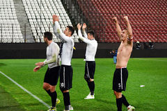 Football players celebrating a victory Royalty Free Stock Image