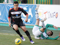 Football players fight for the ball in Concordia Chiajna-Gaz Metan Medias. Football players pictured in action during the Romanian League 1 game between Stock Photos