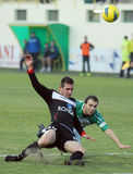 Football players fight for the ball in Concordia Chiajna-Gaz Metan Medias. Football players pictured in action during the Romanian League 1 game between Royalty Free Stock Photos