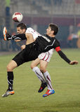 Football players fight for the ball in Rapid Bucharest-Sportul Studentesc Stock Image