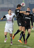 Football players fight for the ball in Rapid Bucharest-Sportul Studentesc Royalty Free Stock Images