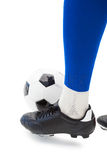 Football players foot with ball Royalty Free Stock Photos