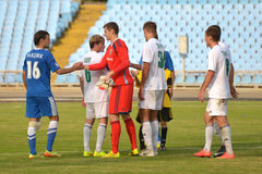 Football players are greeting each other after the match Stock Images