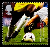 Football Players Hampden Park, Glasgow, Millennium Projects 10 - `Body and Bone` serie, circa 2000. MOSCOW, RUSSIA - OCTOBER 3, 2017: A stamp printed in Great royalty free stock photography