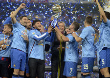 Football players lifting a trophy Royalty Free Stock Images