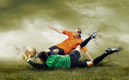 Football players outdoors Stock Images