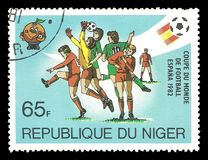 Football players in the penalty area. Niger - CIRCA 1981: Stamp printed by Niger, Multicolor edition on topic of Spain World Football Cup 1988, shows football Royalty Free Stock Photos