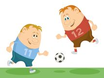 Football players playing soccer Royalty Free Stock Images
