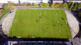 Football players running around the football field. Top view of the football youth tournament stock images