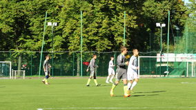 Football players running stock footage
