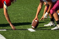 Football Players setting up for the play stock photo
