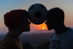 Football Players Silhouetted Colors Stock Images