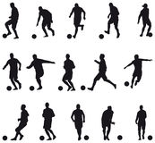 Football players silhouettes Stock Photos