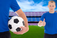 Football players with soccer ball on field of big stadium Royalty Free Stock Photos
