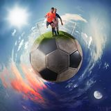 Football players in a soccer ball planet royalty free stock photos