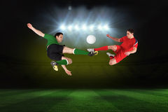 Football players tackling for the ball Stock Images