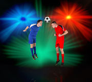 Football players tackling for the ball Royalty Free Stock Photos