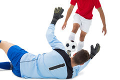 Football players tackling for the ball. Over white background Royalty Free Stock Photography