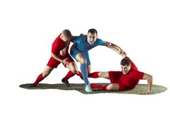 Football players tackling for the ball over white background. Professional football soccer players in motion isolated white studio background. Fit jumping Stock Photos