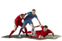 Football players tackling for the ball over white background. Professional football soccer players in motion isolated white studio background. Fit jumping Stock Photo