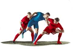Football players tackling for the ball over white background. Professional football soccer players in motion isolated white studio background. Fit jumping Stock Photography