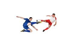 Football players tackling for the ball Royalty Free Stock Photography