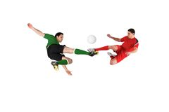 Football players tackling for the ball Stock Photo