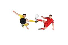 Football players tackling for the ball Stock Photography