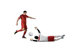 Football players tackling for the ball. On white background Royalty Free Stock Photos