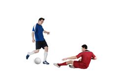 Football players tackling for the ball. On white background Stock Photos
