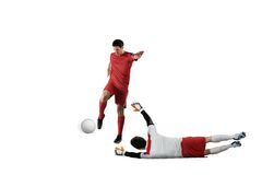 Football players tackling for the ball. On white background Stock Photography