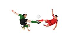 Football players tackling for the ball Stock Photos